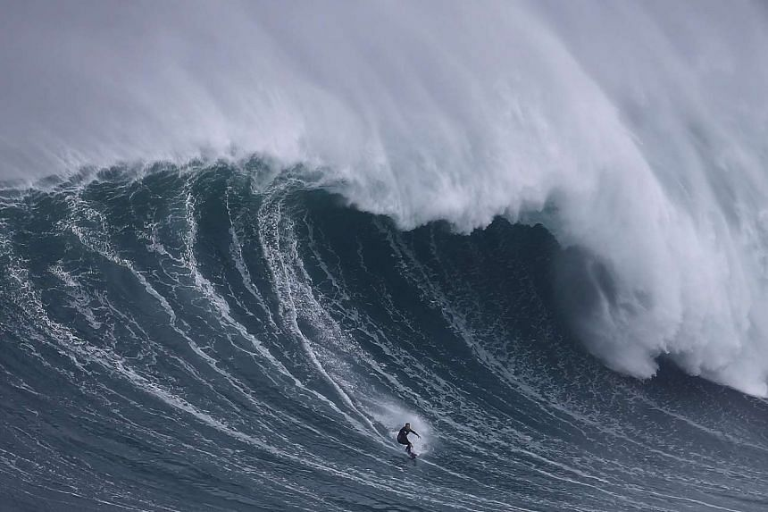 Surfer Sebastian Steudtner of Germany drops in on a large wave at Praia do Norte in Nazare, Portugal, earlier this month. The better waves on every accessible coast are overcrowded. Even mediocre spots are often mob scenes. A multibillion-dollar surf