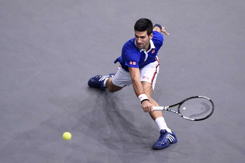 Serbia's Novak Djokovic returns the ball to Switzerland's Stan Wawrinka during their semi-final tennis match at the ATP World Tour Masters 1000 indoor tennis tournament in Paris on Nov 7, 2015.