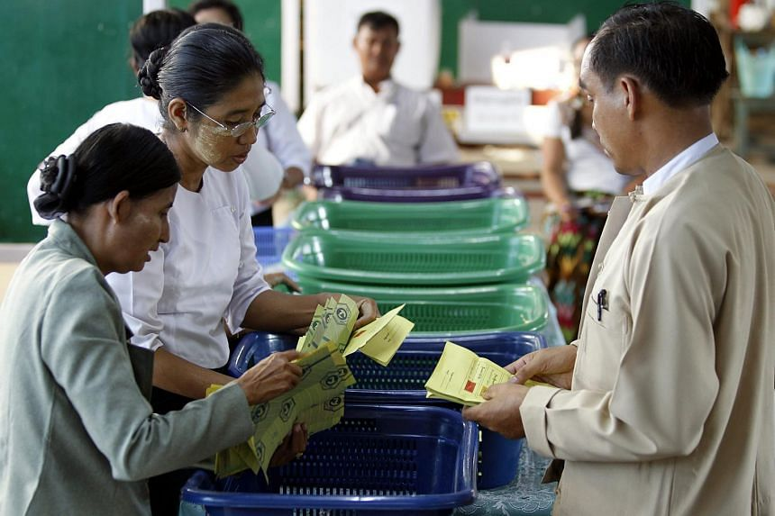 Myanmar election staff count votes at a polling station in Mandalay, Myanmar, on Nov 8, 2015.