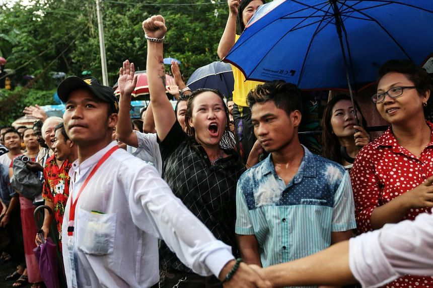 National League for Democracy party supporters cheer as they gather to hear first election results outside the party headquarters in Yangon, Myanmar, on Nov 8, 2015.