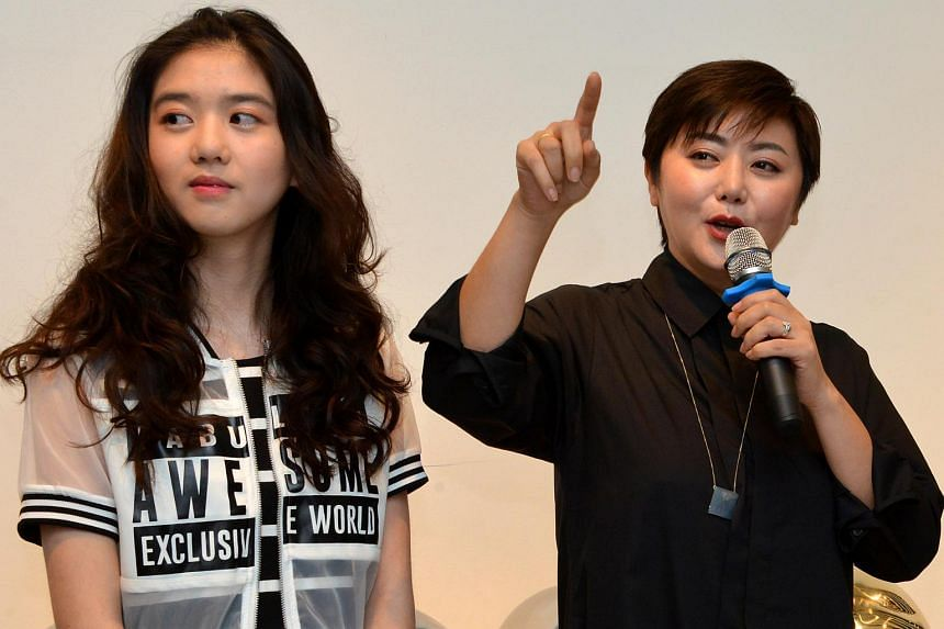 Eleanor Lee (left) may only be 16 years old, but she commands a six-figure sum for her acting and commercial gigs. Her mother, host Quan Yifeng is on her right.