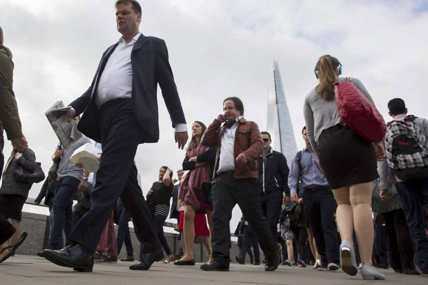 Commuters cross London Bridge in London, in this Aug 6, 2015, file picture.
