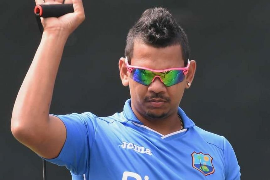 West Indies cricketer Sunil Narine stretching during a practice in Colombo, Sri Lanka, on Nov 6, 2015.
