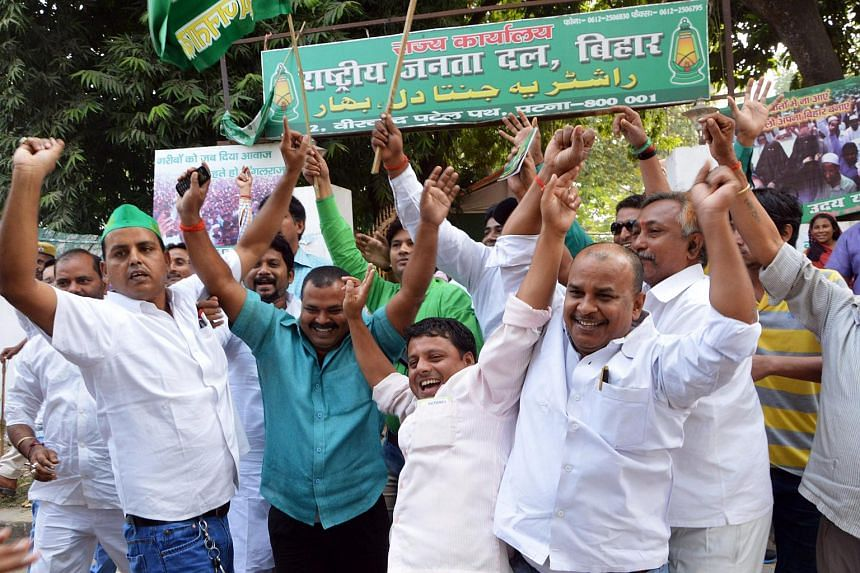Supporters celebrate the Grand Alliance's victory in the Bihar assembly elections in Patna, India, Nov 8, 2015.