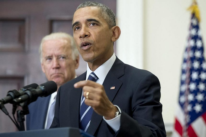 US President Barack Obama (right) delivers a statement on the Keystone XL pipeline.