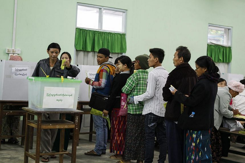 Kachin ethnic people wait to cast their votes at a polling station of Myit Kyee Na township in Kachin State, northern Myanmar, on Nov 8, 2015.