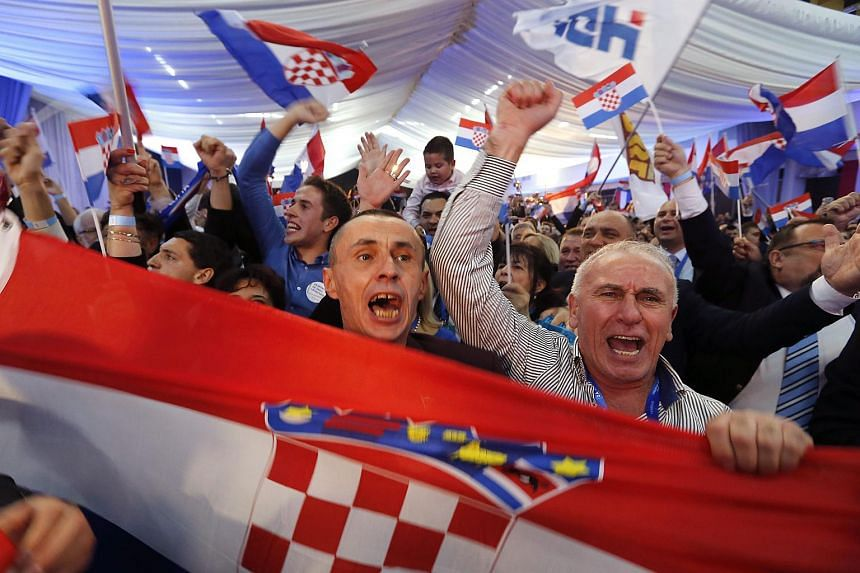 Croatian Democratic Union supporters celebrating their party's election victory in Zagreb on Nov 8, 2015.