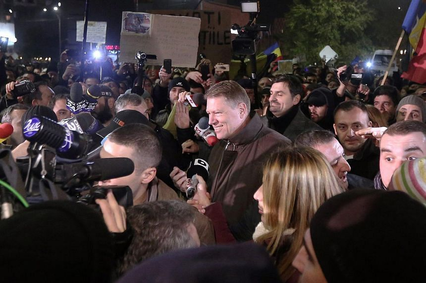 Romanian President Klaus Iohannis speaking to demonstrators protesting at University Plaza after the nightclub fire accident.