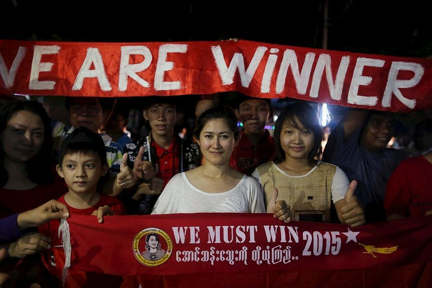 NLD supporters awaiting the results of the polls outside the party's headquarters in Yangon.