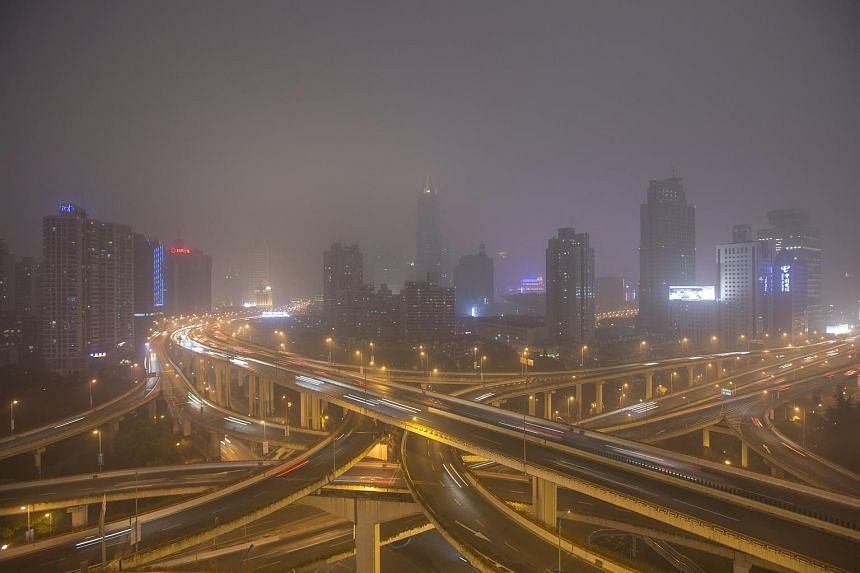 Downtown Shanghai on a hazy night in this Jan 25, 2015 file photo.