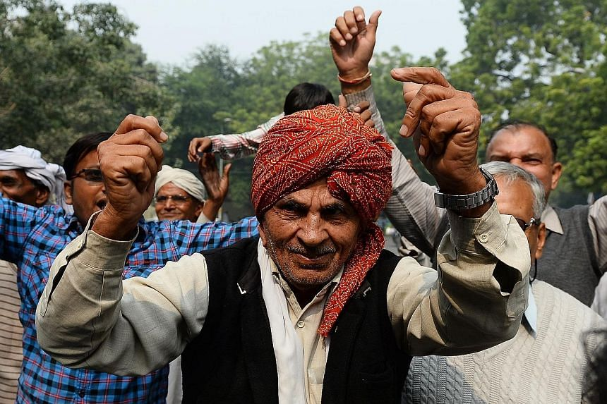 Janata Dal (U) supporters celebrating after an alliance, led by their party, won the Bihar state polls.