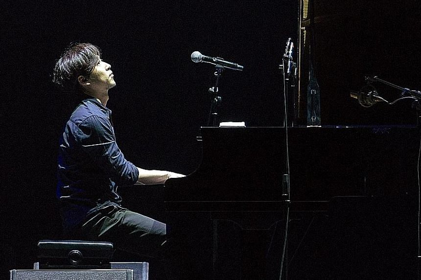 South Korean composer- pianist Yiruma performing at Live In Singapore 2015.