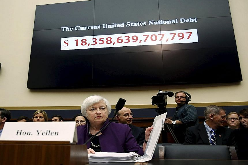 """Fed chief Janet Yellen getting ready to testify before the US House Financial Services Committee in Washington DC last Wednesday. She said a rate hike would be """"the prudent thing to do""""."""