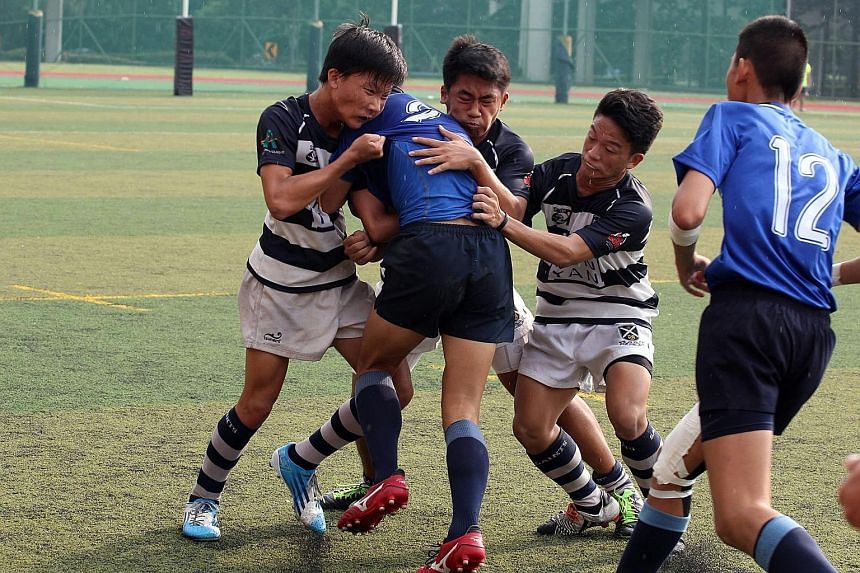 Thailand's Vajiravudh College were the big winners in the Saints Sevens Rugby Tournament yesterday, winning the Under-16 and U-18 Cup competitions. They also finished runners-up in the U-14 event, losing 0-12 to St Andrews Team A (above). The annual