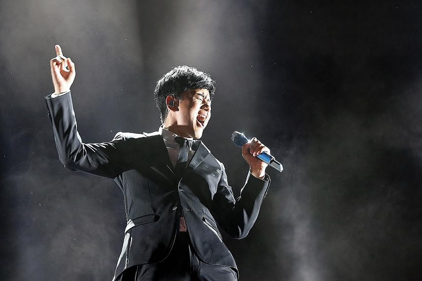 Among the night's performers were China's Zhang Jie (above) and Hong Kong singer Alex To, who received an Honorary Award for his contributions to the Mandopop industry.