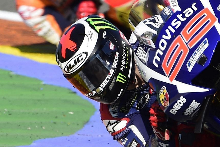 Jorge Lorenzo in the lead with Marc Marquez on his tail yesterday. Valentino Rossi's fourth place in Valencia meant he ended five points behind Lorenzo in the championship with 325.