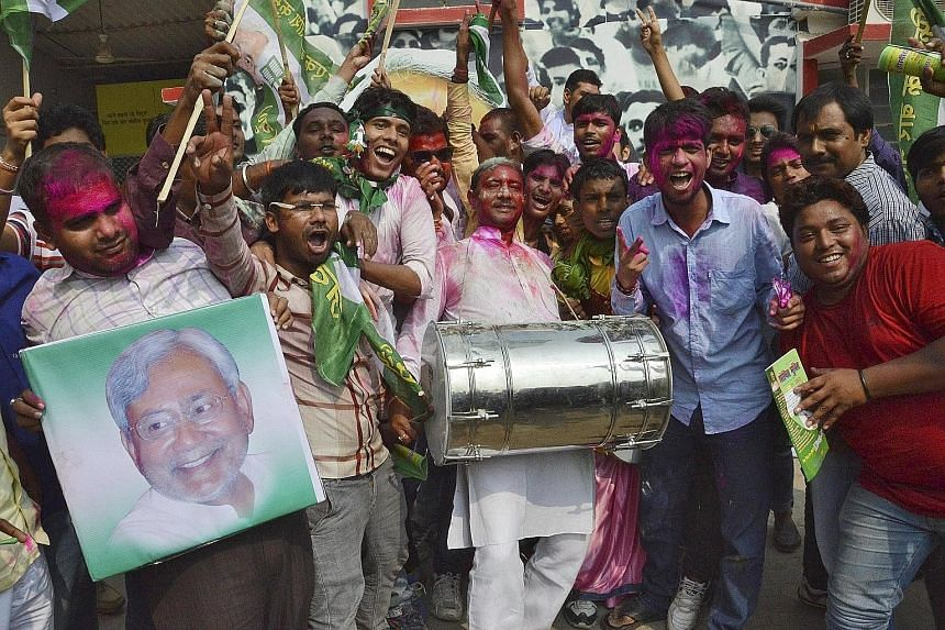 Janata Dal (United) party supporters celebrating after learning of the initial poll results at their party office in Patna, Bihar, yesterday. Mr Modi, who addressed over two dozen rallies in the state ahead of the polls, yesterday accepted defeat and