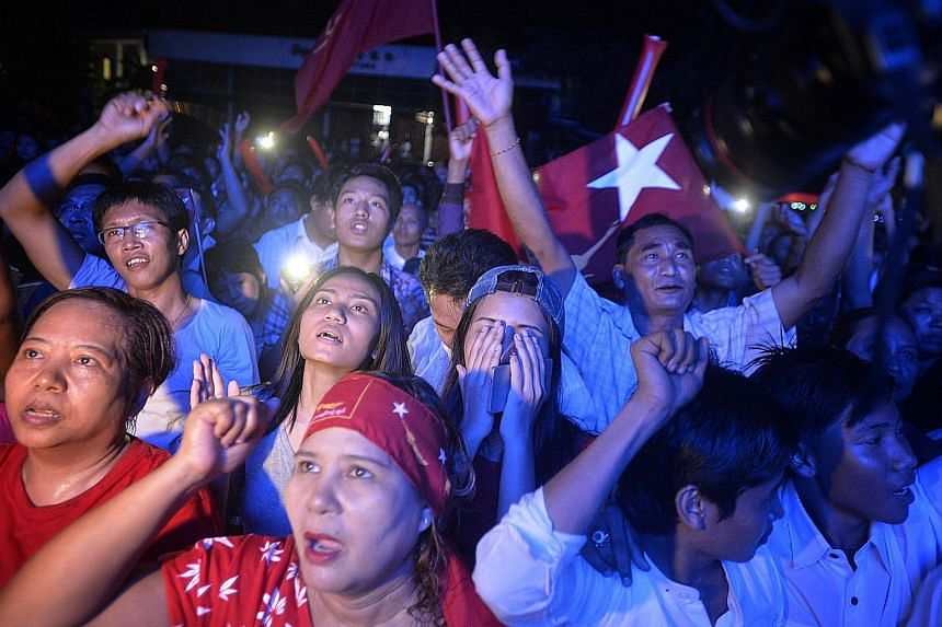 National League for Democracy supporters singing in anticipation of victory outside the party's headquarters in Yangon yesterday.