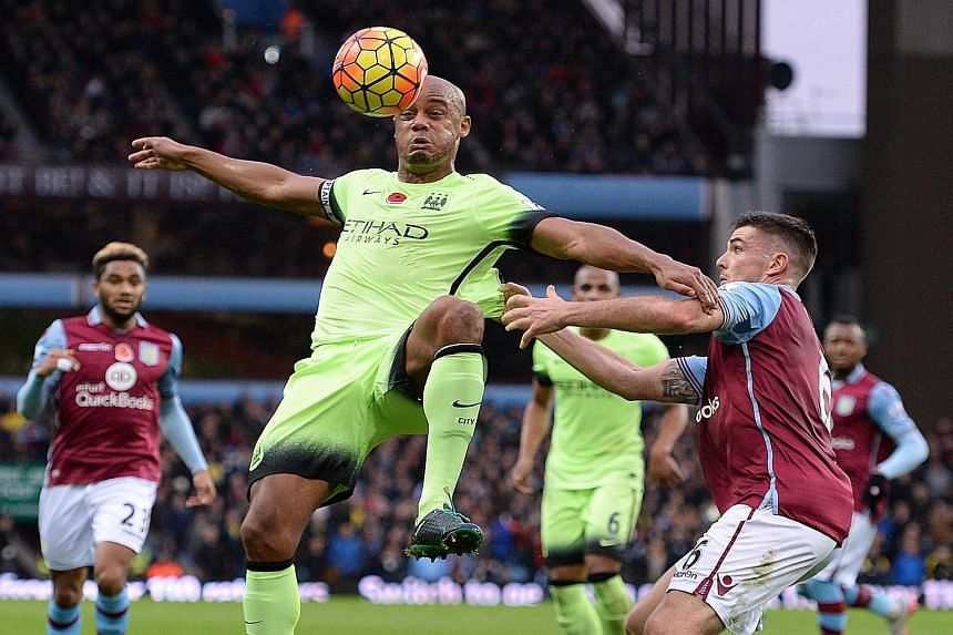 Manchester City's Vincent Kompany (left) vying with Aston Villa defender Ciaran Clark during their Premier League match yesterday. City have now stumbled to two 0-0 draws in their last three games and had no answers against underdogs Villa, a transfo
