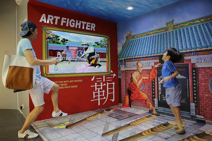 The new exhibits include the Art Fighter game (above) and there is also a new supernatural- themed zone.