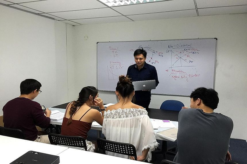 Tutor Shaun Lim, conducting a tuition class at Quintessential Education Centre