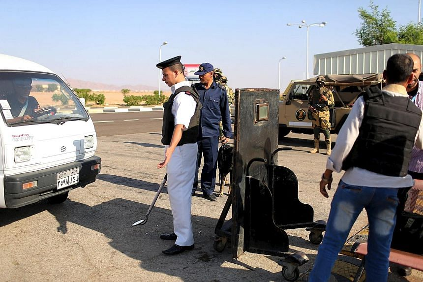 Police officers inspecting cars going into Sharm el-Sheikh airport last Saturday. The crash of a Russian jet has piled pressure on the airport.