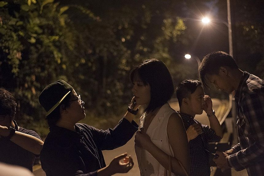 She Jiaqian and Oliver Chong (second from right) preparing to film for 5 To 9.