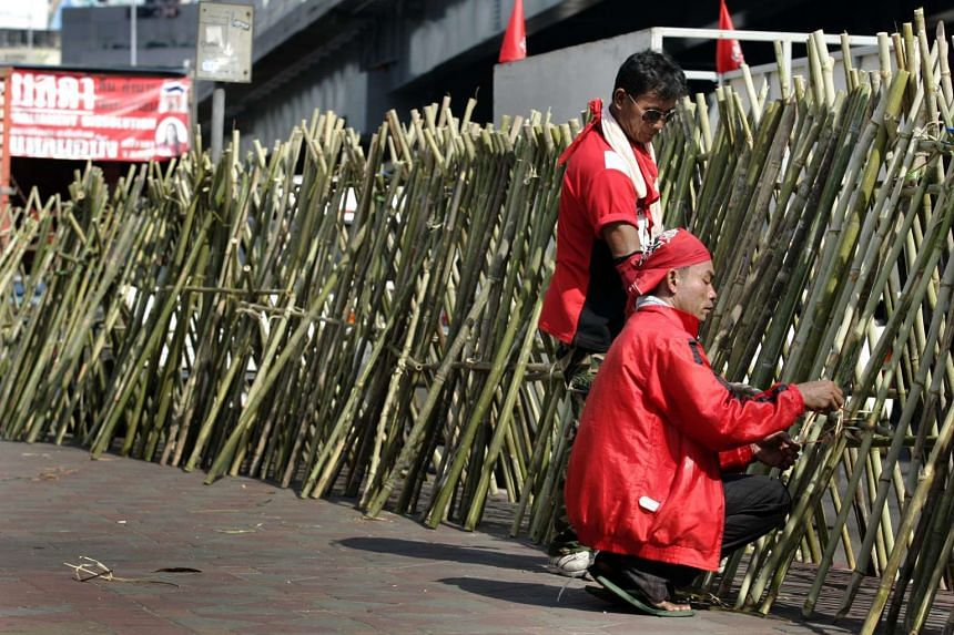 """Thai """"red shirt"""" protesters fortifying a barrier on April 20, 2010."""