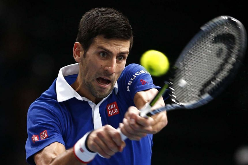 Novak Djokovic of Serbia returns the ball to Andy Murray of Great Britain during the final match at the BNP Paribas 2015 Masters in Paris on Sunday.