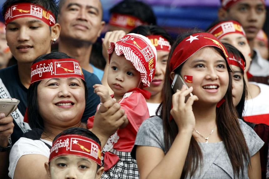 Supporters of the National League for Democracy party celebrating the election results in Yangon on Monday.