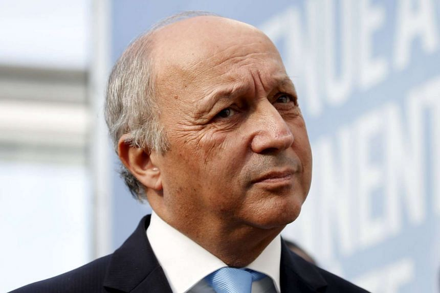 French Minister of Foreign Affairs Laurent Fabius visits the work site on Sunday where the forthcoming COP 21 World Climate Summit will be held at Le Bourget, near Paris.