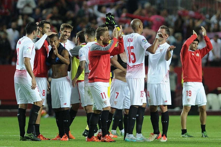 Sevilla players celebrate their 3-2 victory over Real Madrid CF on Sunday.
