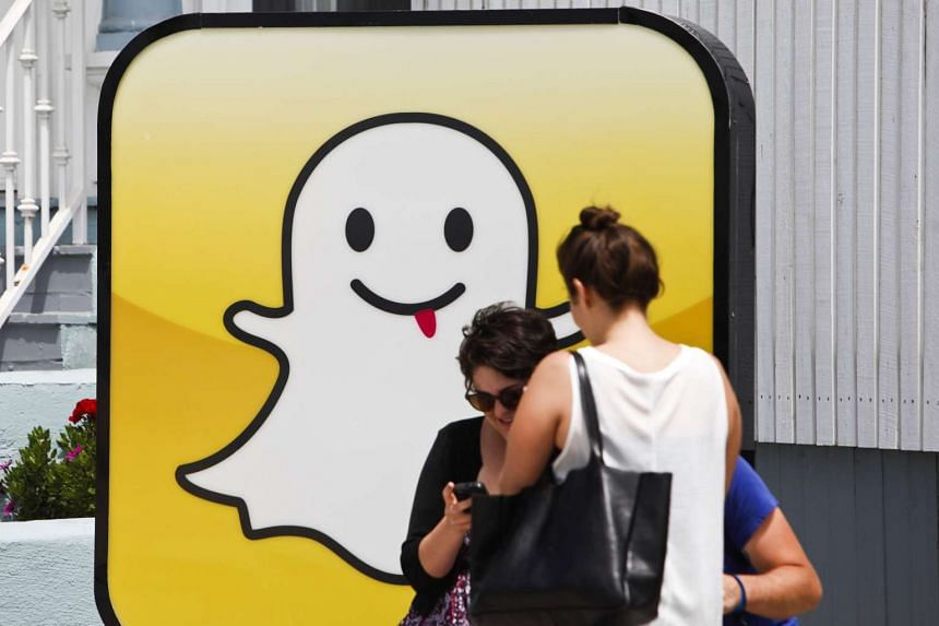 People take pictures in front of the Snapchat headquarters at Venice Beach in Los Angeles.