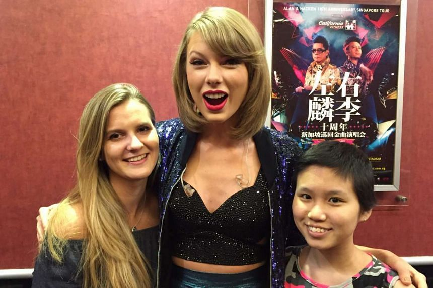 Dominique Schell (left) and Michelle Liew (right) meet US pop star Taylor Swift backstage at her concert in Singapore.