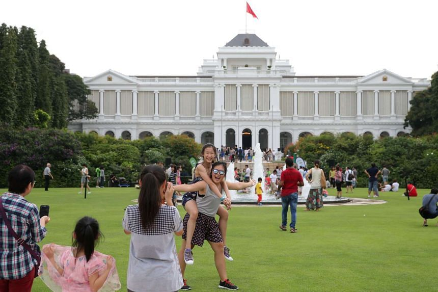 High jinks and horseplay at the Istana grounds as visitors snapped cheeky shots of themselves during the open house on May 1, 2015.