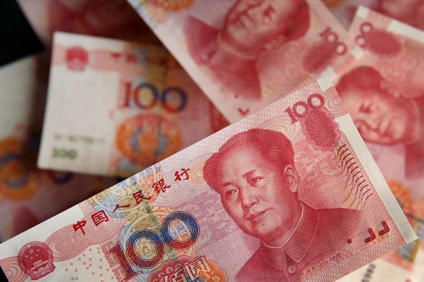Chinese one-hundred yuan banknotes are arranged for a photograph in Tokyo, Japan, on Tuesday, Aug 11, 2015.