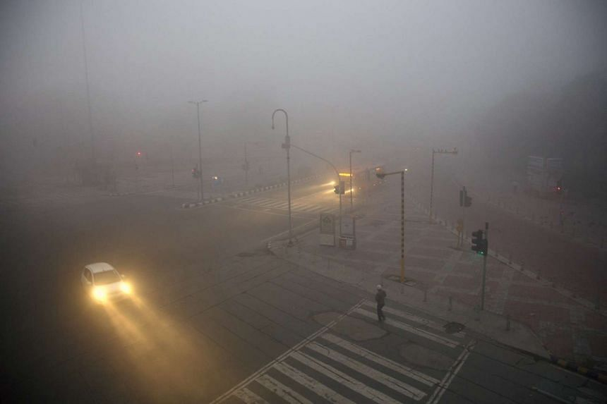 New Delhi streets shrouded in haze in 2014. India has joined a list of the biggest contributors to global warming.