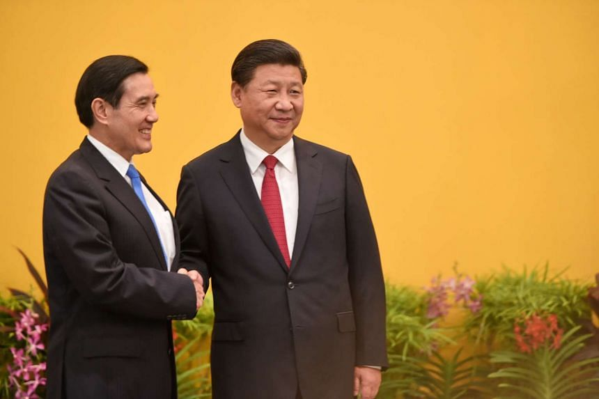 Chinese President Xi Jinping (right) shakes hands with Taiwan President Ma Ying-jeou before their meeting in Singapore.