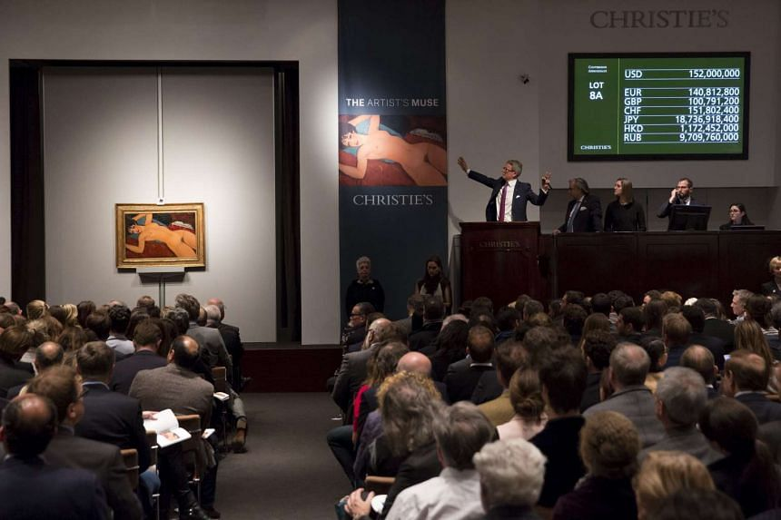 Christie's auctioneer Jussi Pylkkanen auctions Amedeo Modigliani's Nu couche during a curated auction in New York.