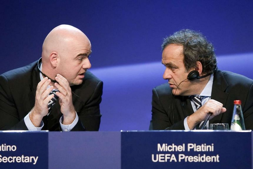 Uefa secretary general Gianni Infantino (left) speaking with Uefa president Michel Platini during a press conference in Tel Aviv on March 25, 2010.