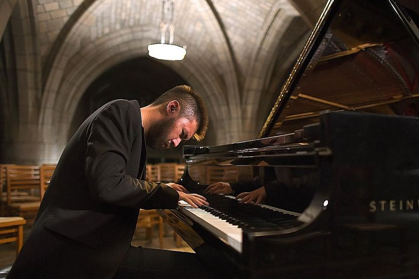 Pianist Conrad Tao (left) playing in a crypt under the Church of the Intercession in New York.