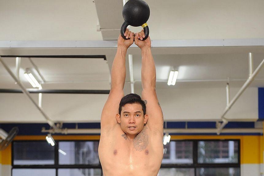 Mr Leonard Kong, 31, doing kettlebell swings, one of the CrossFit exercises.