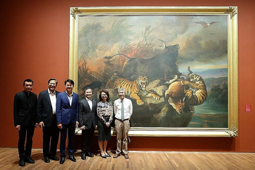 Mr Danny Yong (third from left), with (from left) National Gallery Singapore director Eugene Tan, board member Jose Isidro Camacho, chairman Hsieh Fu Hua, CEO Chong Siak Ching and board member Kenson Kwok, in front of Forest Fire, a painting dedicate