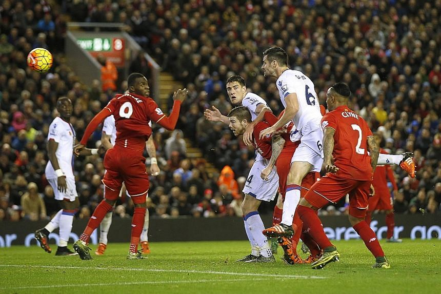 Crystal Palace's Scott Dann (second from right) heads home in the 82nd minute at Liverpool in their Premier League clash on Sunday. The Reds' 1-2 loss was their first defeat of the Klopp era.