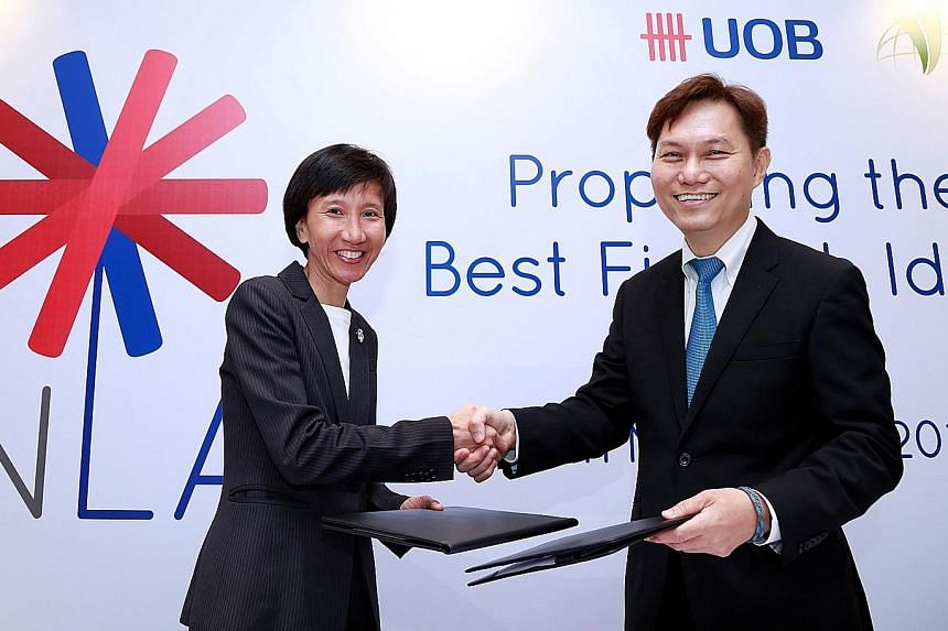 Ms Janet Young of UOB and Dr Alex Lin of IIPL after signing the joint venture agreement for The FinLab. Each start-up will get about $30,000 and UOB will take a small stake in the start-ups.