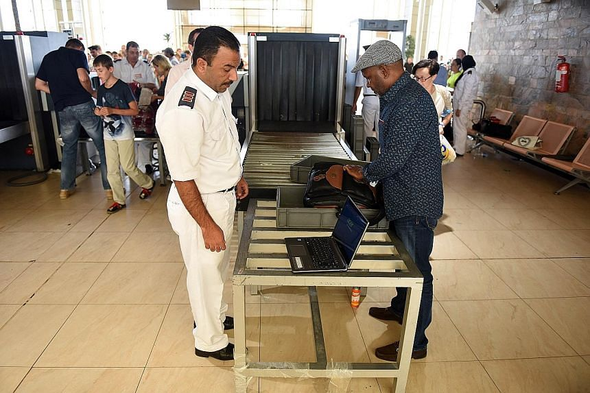 A passenger having his luggage checked at Sharm el-Sheikh airport in Egypt in the wake of the Oct 31 plane crash at the Red Sea resort.