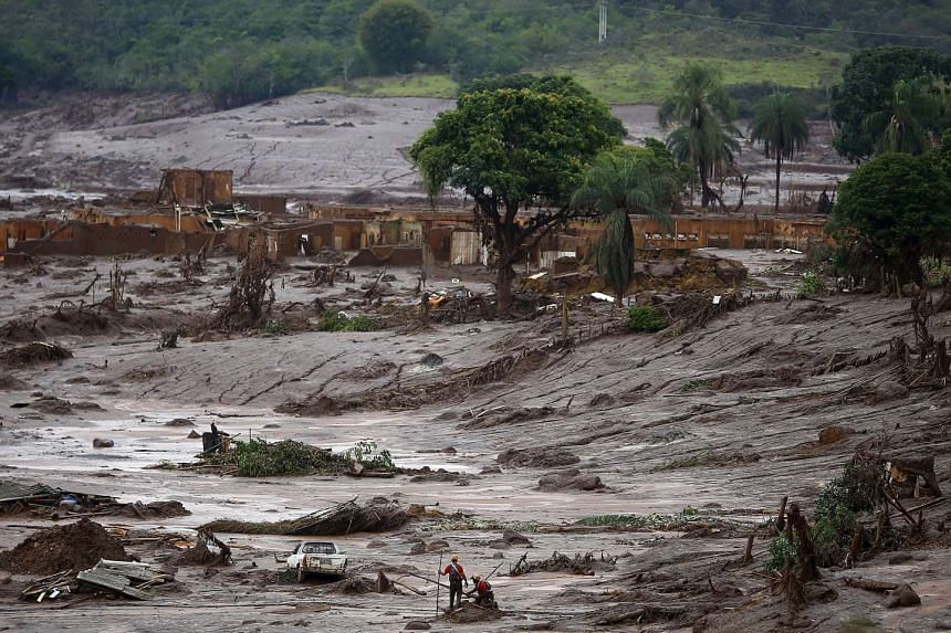 Rescue workers searching for victims at Bento Rodrigues district after a dam burst, in Mariana, Brazil, on Nov 8, 2015.
