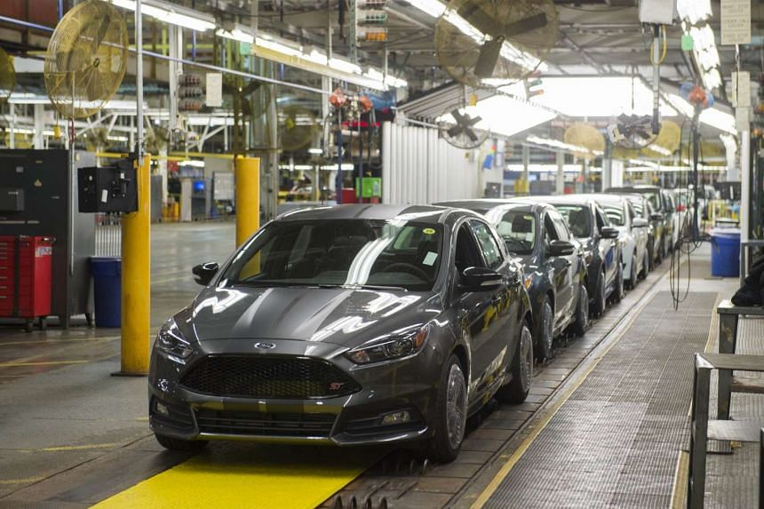 Ford Focus vehicles are seen on an assembly line at the Ford Michigan Assembly Plant in Wayne, Michigan, on Jan 7, 2015.
