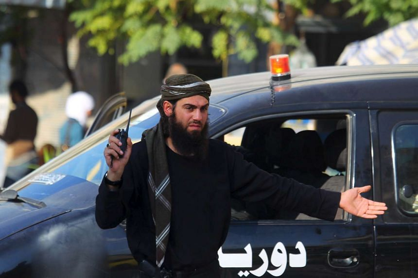 A member of a coalition rebel group Jaish al Fateh, or Conquest Army, controls the traffic in Idlib, Syria.