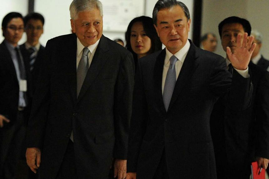 Chinese Foreign Minister Wang Yi (right) arriving with his Philippine counterpart Albert del Rosario at the foreign affairs office in Manila on Nov 10.